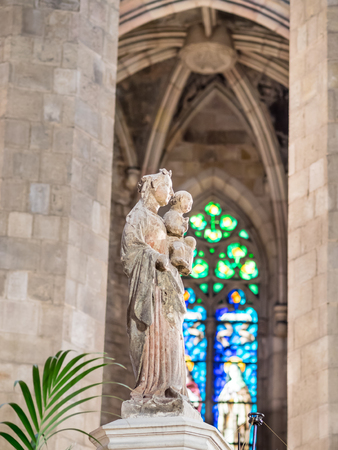 BARCELONA, SPAIN - FEBRUARY 22, 2015: Statue of the virgin in Santa Maria del Mar gothic cathedral, in Barcelona. The cathedral was built between 1329 and 1383.