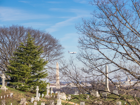 WASHINGTON DC, USA - DECEMBER 26, 2014: A Commercial Flight flying over the Arlington cemetery near to land in Ronald Reagan airport.