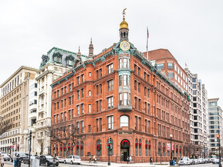 Washington, D.C. - December 29, 2014:  The historic SunTrust building in Washington DC downtown. Build with red bricks and a gold dom tower with a clock. 報道画像