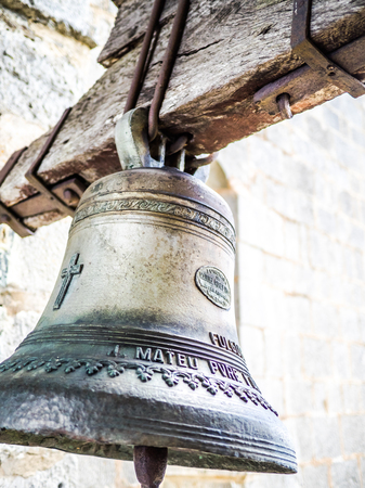 Figueres, Spain - September 20, 2014: A beautiful bell seen on the Mare de Deu del Mont sanctuary (Understandable Text: Manuel Roses foundry, Valencia)