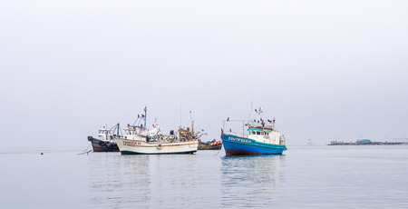 Paracas - Peru, October 15, 2014: View of a group of anchored fisher boats in a cloudy morning in Paracas, Peru 報道画像