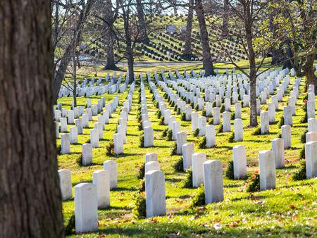 WASHINGTON DC, USA - DECEMBER 26, 2015: Gravestones on Arlington National Cemetery decorated for Christmas time.