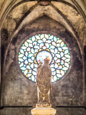 BARCELONA, SPAIN - FEBRUARY 22, 2015: Statue in Santa Maria del Mar gothic cathedral, in Barcelona. The cathedral was built between 1329 and 1383.