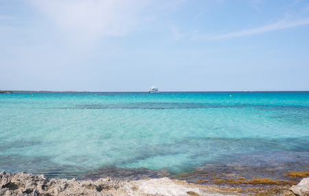 A boat over the blue Formentera waters Stock Photo