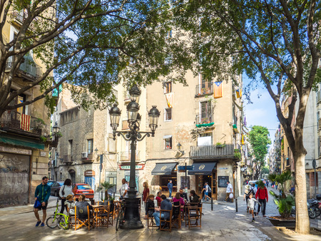 Barcelona, Spain - October 30, 2016. View of tourists enjoying Barcelona in Sant Agusti Vell square.