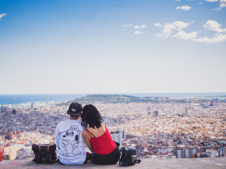 Barcelona, Spain - September 10, 2017: View of a couple watching the city of Barcelona from the Carmel's bunkers