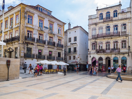 Coimbra, Portugal - July 10, 2017: View of the old buildings in the 8th of may square in Coimbra downtown