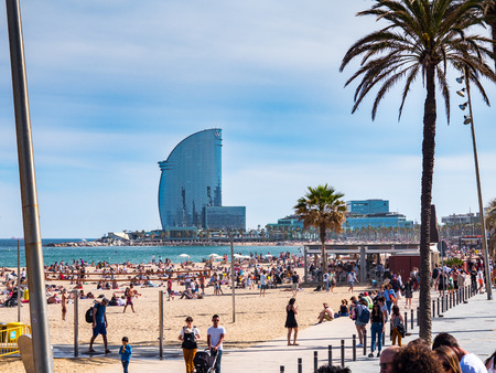Barcelona, Spain - May 21, 2017: View of the tourists over the sand of the Barceloneta beach in Barcelona