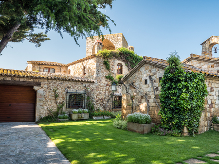 Pals, Spain - March 18, 2017: View of a house in Pals village center Editorial