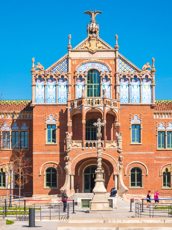 Barcelona, Spain - March 18, 2017: View of the facade in the main central building of the Santa Creu i Sant Pau hospital (Holy Cross and Saint Paul Hospital) complex Editorial