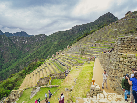Machu Picchu, Peru - January 5, 2017. View of the tourists visiting the Machu Picchu citadel 에디토리얼
