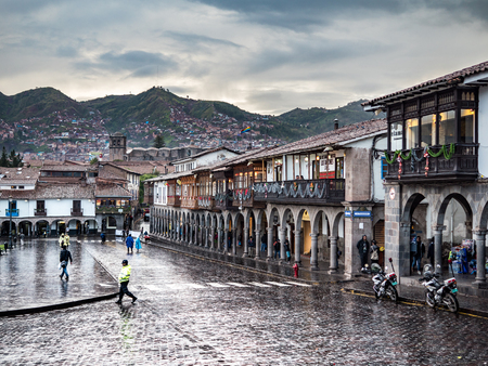 Cusco, Peru - January 7, 2017. View of a side of the Plaza de Armas square in a rainy day Sajtókép