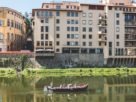 Firenze, Italy - May 27, 2017 - View of tourists in a boat in front of the Ponte Vecchio Editoriali