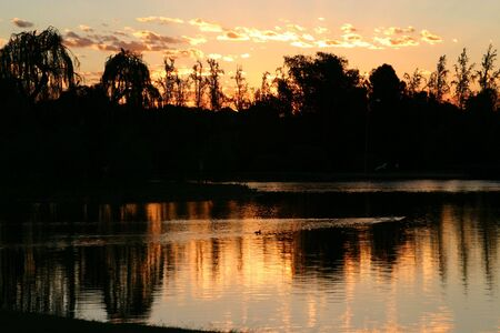 Black and Orange sunset at a lake Stock Photo - 2638984