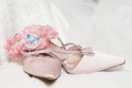 Light Colored wedding shoes on a white gown Stock Photo - 2958183