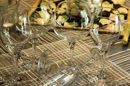 Variety of glasses on a table at a wedding reception photo