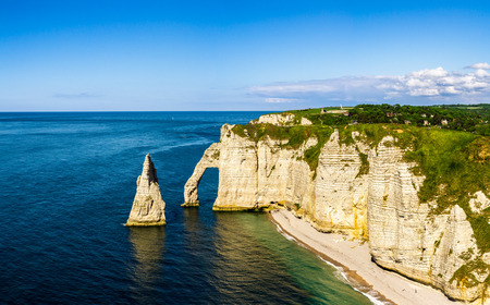 Cliff Seashore with interesting rock formations, destination for tourists that are looking for leisure in beautiful surroundings. France, Normandy, Etretat. Stock fotó