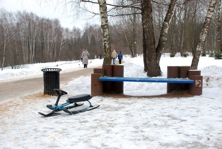 colore: The blue bench for the visitors of the Moscow Park in winter Stock Photo