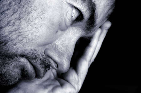 Black and white portrait of stressed man