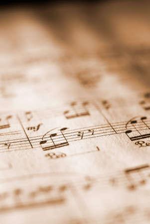 concerto: Hoja de m�sica prestados en tono sepia. [Corta profundidad de campo.]
