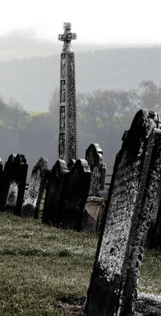 Chilly image of the graveyard featured in Bram Stoker's Dracula on the clifftop overlooking Whitby harbour in North Yorkshire, England.