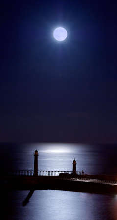 whitby: Whitby Piers by moonlight. Stock Photo