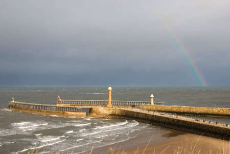 Rainbow over the twin piers at Whitby in North Yorkshire, England.