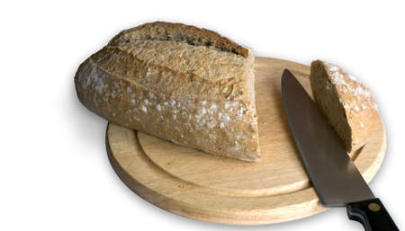 Loaf of bread being sliced.  [Clipping path.] photo