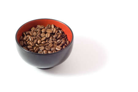 tonne: A simple bowl of coffee beans.  [Isolated on white background.]