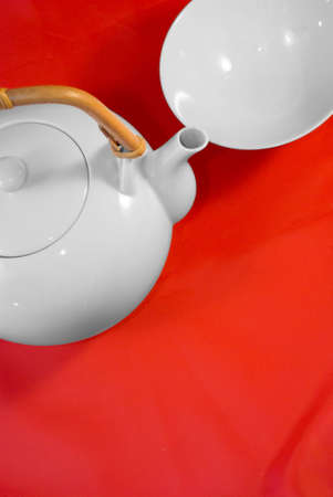 free radicals: White japanese tea service on red silk background. Stock Photo