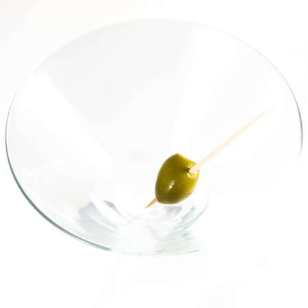 Cocktail glass with olive. Shot from above.  [Short depth of field.] photo