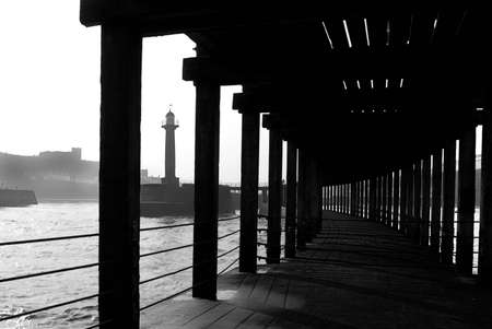 whitby: Lower deck of Whitby pier in sepia