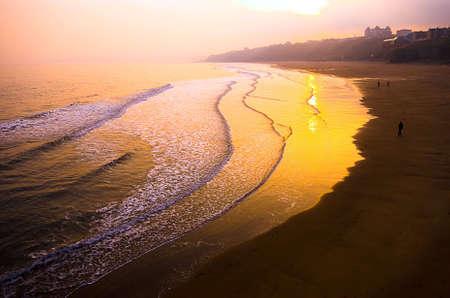 Sunset over Whitby beach Stock Photo