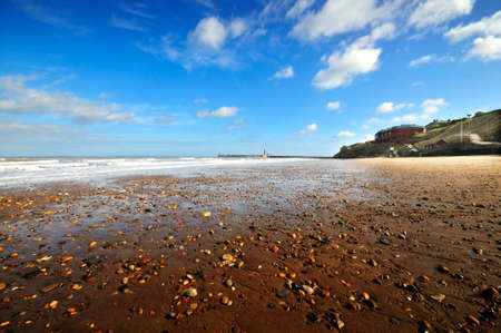 Atmospheric low and wide angle shot of Whitby beach Stock Photo