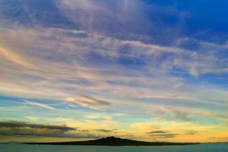 Rangitoto Island in Auckland under dramatic sky. Stock Photo