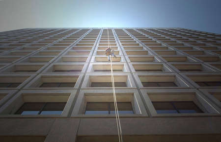 abseil: High-rise window cleaner in Toronto, Canada.