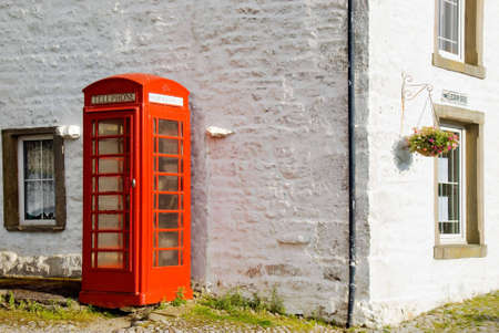 phonebox: Phonebox standing against telegraph office in Yorkshire Dales