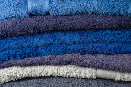 Blue flufy towels stacked together