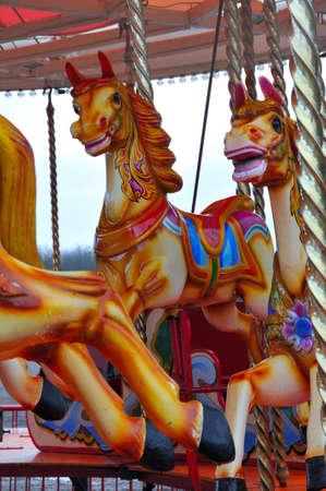 Horses on a carousel photo