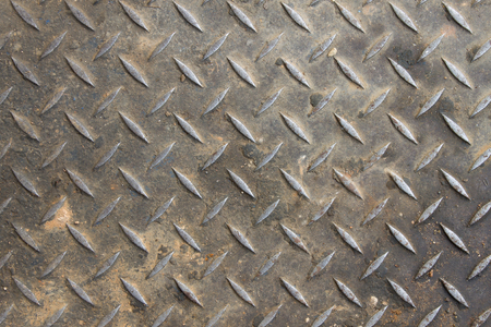 Old diamond plate background and small sand with dirt photo