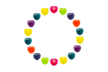 Heart shape confectionery is set in circle style on white background Stock Photo - 24933231
