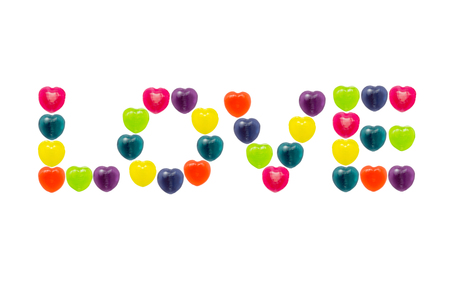 Heart shape confectionery is set in love text style on white background Stock Photo - 24933233