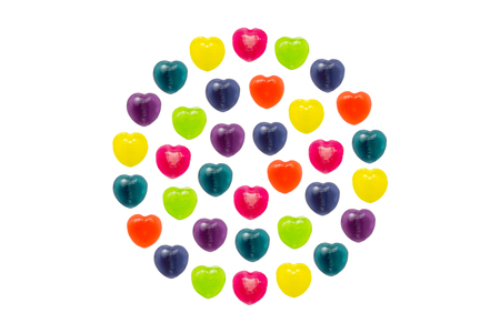 Heart shape confectionery is set in full circle style on white background Stock Photo - 24933294