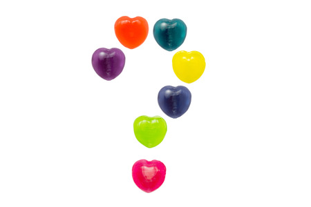 Heart shape confectionery is set in question mark style on white background Stock Photo - 24946468