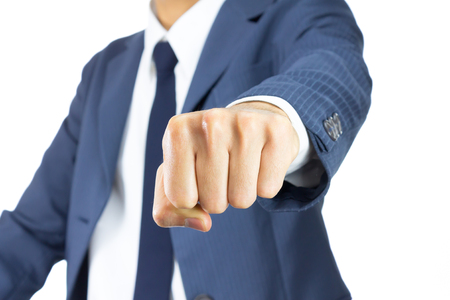 robust: Businessman Fist in Blue Suit Isolated on White Background. Concept about Violence or Strike in Organization