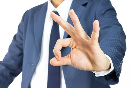 concur: Businessman in Blue Suit Show OK Sign Hand Isolated on White Background. Concept about Acceptance or Agreement