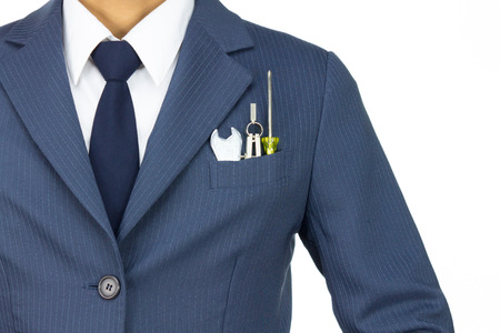 Businessman in Blue Suit with Wrench and Dividers and Screwdriver in Pocket Isolated on White Background. Concept about Technique or Mechanic or Repairing or Maintenance.
