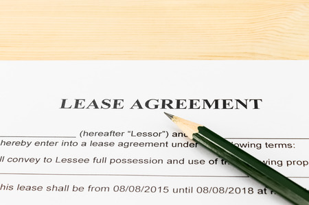 legal document: Lease Agreement Contract Document and Pencil Horizontal View on Wood Table in Vintage Style. Legal document for business event Stock Photo