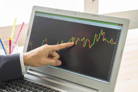 technical analysis: Businessman is pointing stock graph or forex graph . Technical analysis forex or stock by professional trader Stock Photo