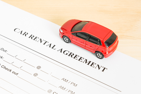 legal document: Car rental agreement with red car on right view. Auto rental agreement or legal document